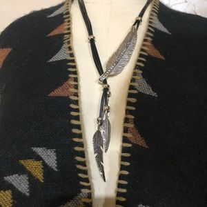 Silver feather pendant & tassel necklace on black